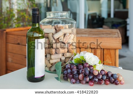 Wine bottle and Grapes decorate on the table - stock photo
