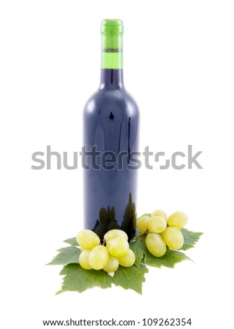Wine Bottle and grapes with leaves.
