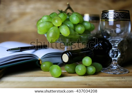 wine bottle book and glass grape
