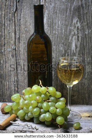 wine bottle, grapes and a glass of wine