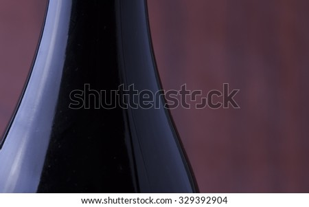 Wine bottle in strict close up, with copy space, horizontal image - stock photo