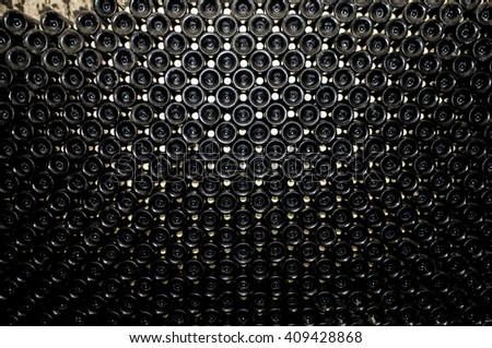 Wine bottle in wine cellar - stock photo