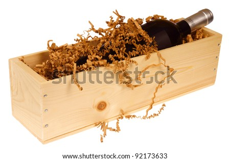 Wine bottle in wooden box, isolated on background