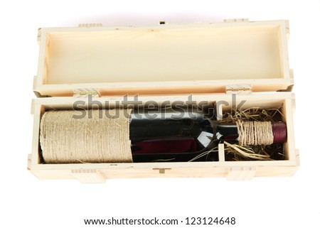 Wine bottle in wooden box, isolated on white - stock photo