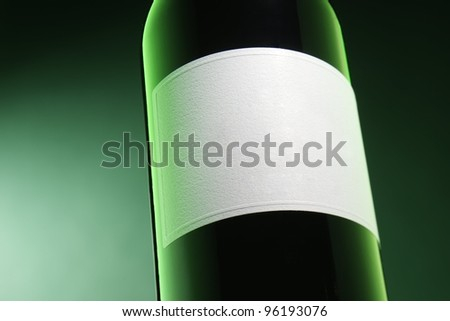 Wine bottle on green background