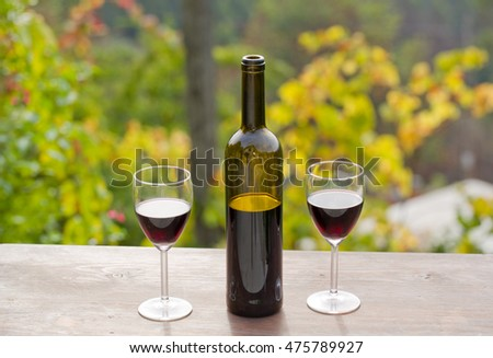 wine bottle on wooden table, outdoor