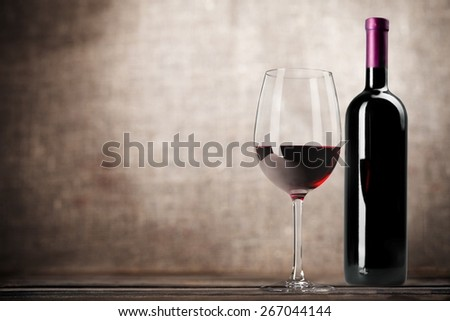Wine Bottle. Red wine bottle and glass, isolated on white background - stock photo