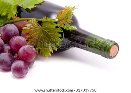Wine bottles and grapes. Isolated on white background - stock photo
