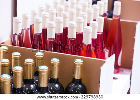 wine bottles at  store or winery factory  - stock photo