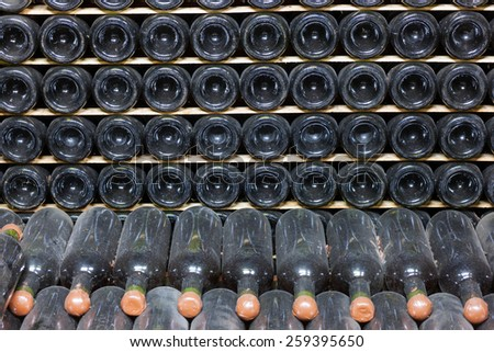 Wine bottles in a wine-cellar - stock photo