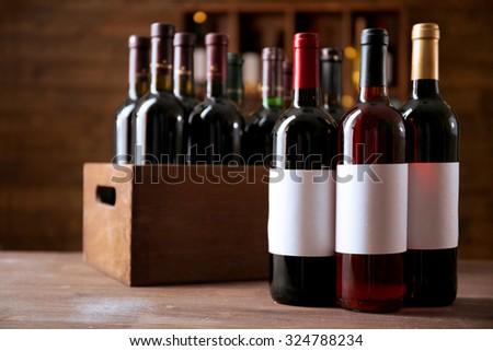 Wine bottles in cellar - stock photo