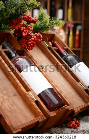 Wine bottles in decorated wooden boxes at the shop - stock photo