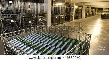 Wine bottles in wine cellar factory France - stock photo