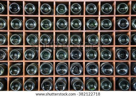 wine bottles on a shelf background - stock photo