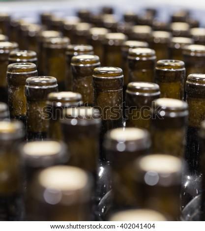 wine bottles on the conveyor, production of wine - stock photo