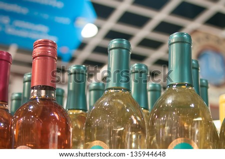 Wine bottles shot with limited depth of field on display in a liquor store - stock photo