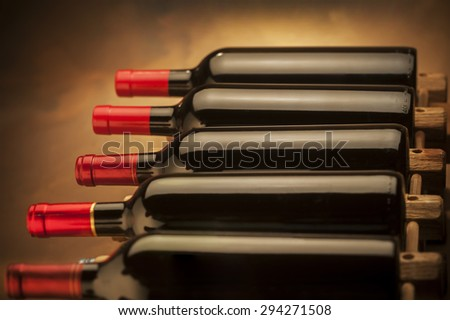 wine bottles stacked horizontally shot with limited depth of field - stock photo