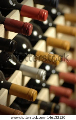 Wine bottles stored in a shelf, very shallow DoF