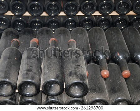 wine bottles stored in the old wine cellar - stock photo