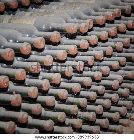 Wine cellar. Bottles sealed with wine in storage - stock photo