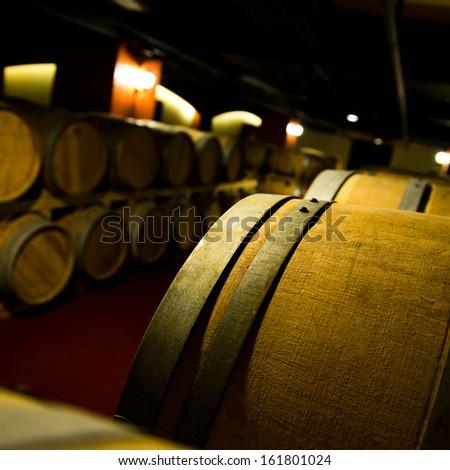 Wine cellar with many wine barrels. - stock photo
