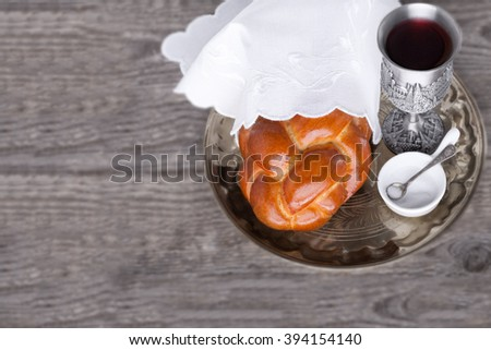 Wine, challah for the Jewish Sabbath. - stock photo