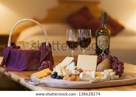 Wine, cheese and grapes for a snack in a luxurious hotel room, Stowe, Vermont, USA