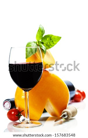 Wine, cheese and italian ingredients over white - stock photo