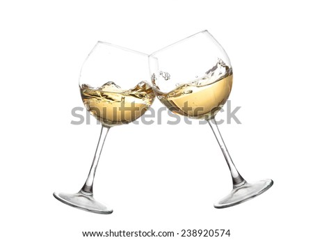 Wine collection - Cheers! Clink glasses with white wine. Isolated on white background. Toasting gesture two white wine glasses with big splash - stock photo