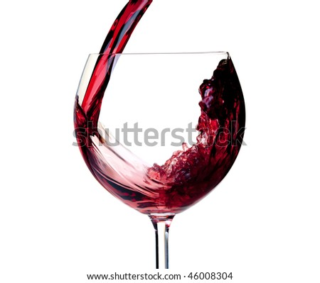 Wine collection - Red wine is poured into a glass. Closeup. Isolated on white background