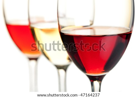 Wine collection - Rose, White and Red wine. Small DOF. Isolated on white background