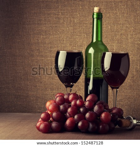 wine composition with grapes and glasses