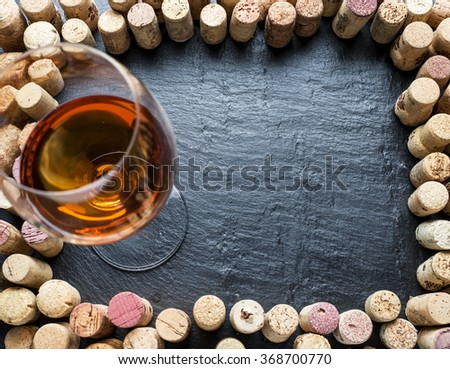 Wine corks arranged as frame on the graphite board. - stock photo