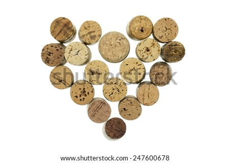 Wine corks form filled with heart shape isolated on white background horizontal - stock photo