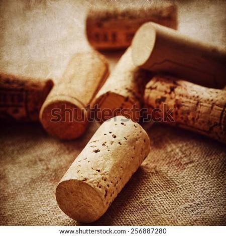 Wine corks on linen background - stock photo
