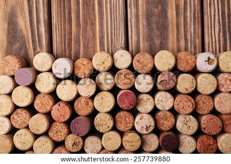 Wine corks on wooden background - stock photo