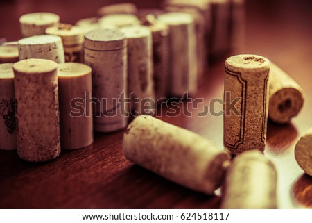 Wine corks on wooden table background closeup photo.