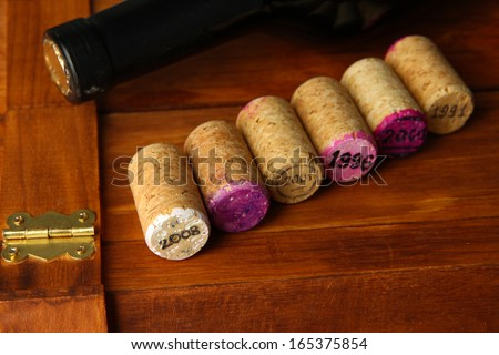 Wine corks with corkscrew on wine boxes close-up - stock photo