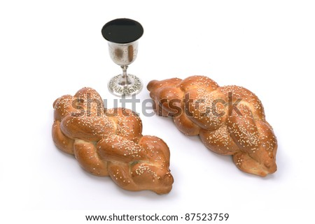 Wine cup and challahs, isolated - stock photo