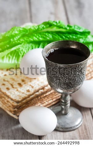 Wine, egg, bitter salad leaves, matzot - traditional jewish passover celebration elements. - stock photo