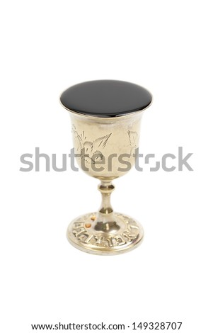 Wine filled silver kiddush cup, isolated on white