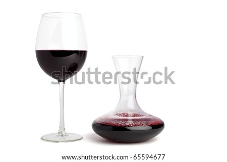 Wine glass and a carafe filled with red wine, isolted on white - stock photo