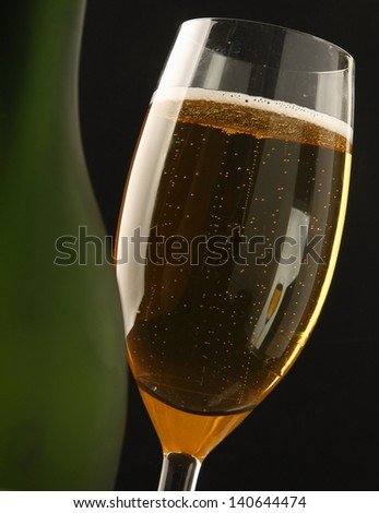 Wine glass and Bottle, isolated on black background