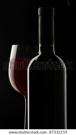 Wine glass and Bottle Isolated on Black background - stock photo