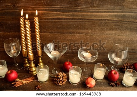 Wine glass,candle and apple.image of party on winter and autumn season.