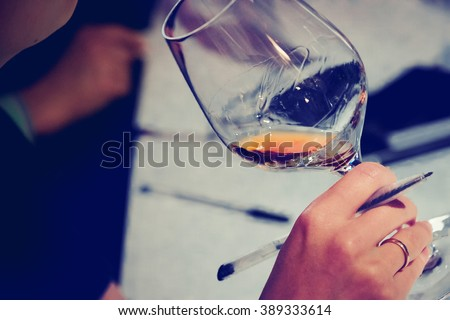 Wine glass degustation catering services background with glasses of wine on bartender counter in restaurant - stock photo