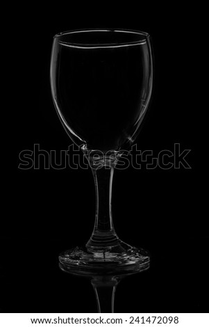 Wine glass in isolated black background. - stock photo
