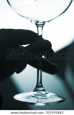 Wine glass in light at night photo.