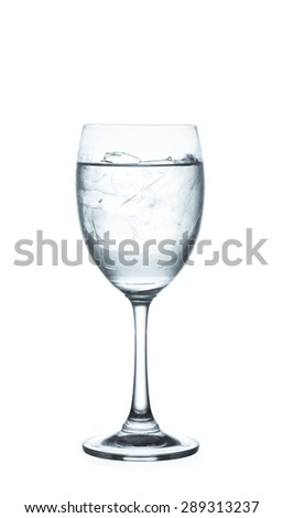wine glass of pure water with ice cubes. Isolated on white background