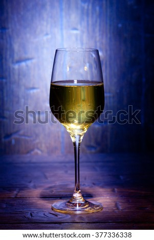 Wine glass on blue old wooden background - stock photo